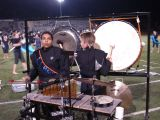 Playing the gong and the bass drum