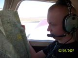 Spencer looking at the flight map prior to takeoff